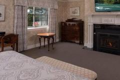 tasner-bedroom-fireplace.1236x617-1