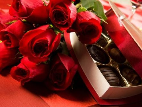 red roses with a box of chocolates