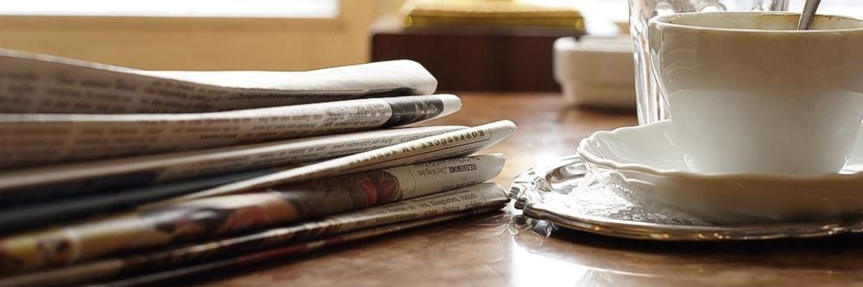 Newspapers with a Cup of Coffee